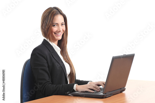 Beautiful business woman smiling and looking at the camera