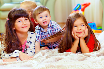 group of cute children listen attentively
