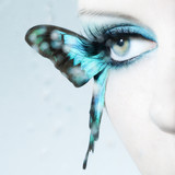 Beautiful woman eye close up with butterfly wings