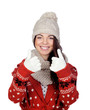 Attractive girl with wool hat and scarf saying Ok