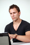 Busy man working on a touch screen device
