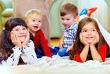Fototapety group of attentive kids in nursery room