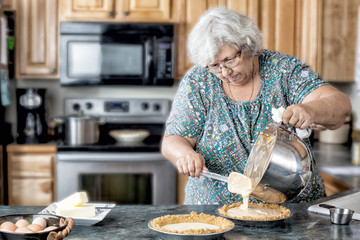 Active grandmother baking