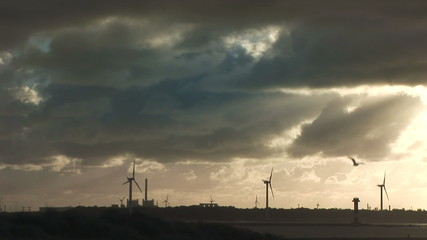 Dutch wind Turbines across the mouth of the Rotterdam waterway