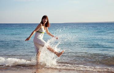 Happy  woman at sea  coast