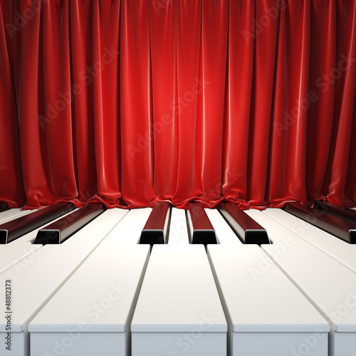 Piano Keys and red curtains.