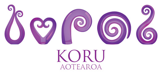 A set of purple glass Maori Koru curl ornaments.
