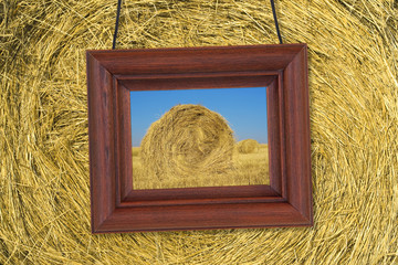 Wooden frame on the background of hay