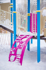 Climbe construction to slides for kids on winter playground cove
