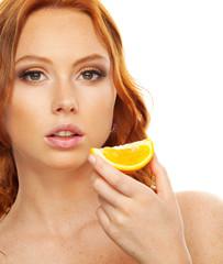Model with slice of orange