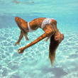 Girl portrait posing underwater with white bikini.