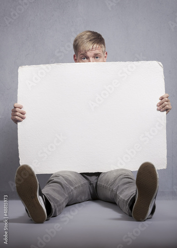 Upset man holding white empty panel.
