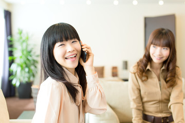 Beautiful asian women relaxing in the room
