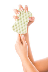 Hand and sponge, isolated on white background