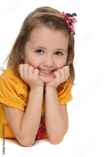 Smiling little girl in a yellow shirt