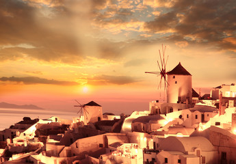 Windmills in Santorini against sunset, Greece