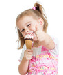 happy kid girl eating ice cream and showing thumb up - 48817722