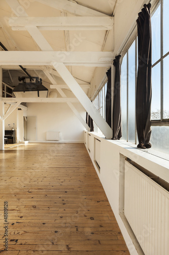 interior old loft, beams and wooden floor, big space