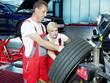 Mechanic is teaching his apprentice