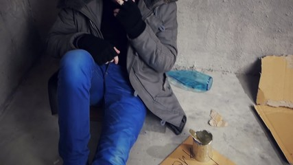 homeless sitting on the floor