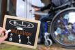 Schild  Inklusion mit Rollstuhlfahrer
