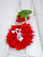 Love garland and red flowers