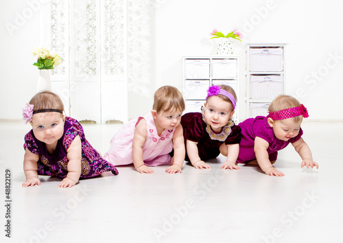 Toddler girls crawling