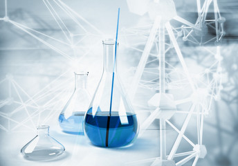 Big laboratory flask on abstract science background