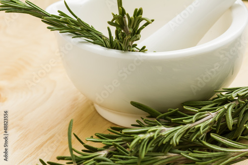 Ceramic mortar and fresh organic rosemary