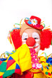 Clown pustet in Tröte