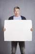 Disoriented man holding white empty panel.