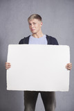 Unhappy man showing white blank panel.