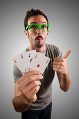 winner guy holding poker cards
