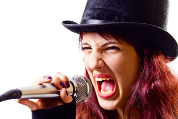 girl with microphone in  black top-hat