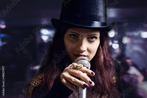 actress with microphone in nightclub