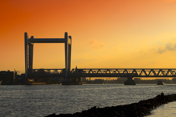 Railway bridge in Dordrecht at sunset with a dramatic sky