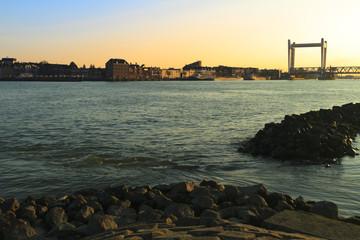 Railway bridge crossing the river in Dordrecht at sunset