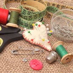 tools for needlework, thread, scissors and tape measure