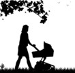 A young mother pushing the stroller in park in spring
