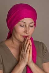 Middle aged woman praying