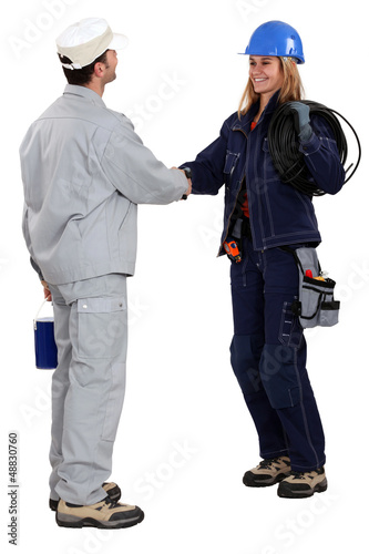 Workers greeting each other