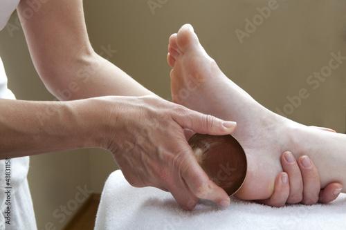 ayurveda massage with kansu bowl