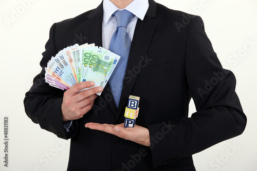 Businessman holding cash
