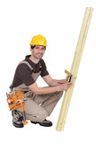 Tradesman taking measurements using a try square