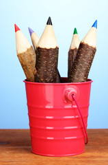 Colorful wooden pencils in pink pail