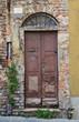 Wooden door. Piacenza. Emilia-Romagna. Italy.