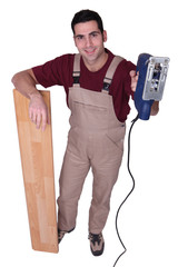 joiner with parquet strips and sander machine