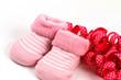 Pink baby socks and pink ribbon