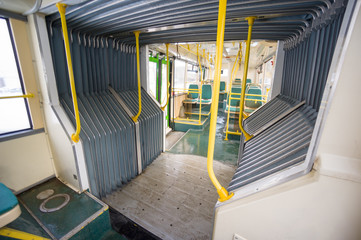 Interior of modern city articulated bus. Articulated joint and s