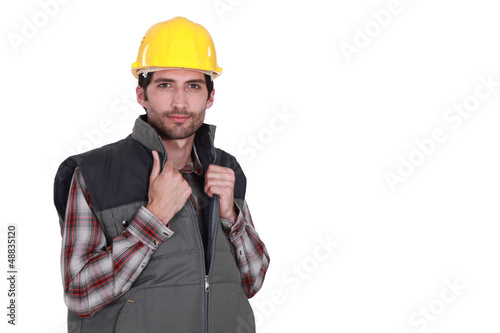 portrait of attractive craftsman isolated on white